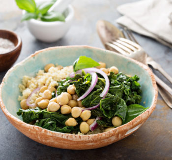 Warm quinoa salad with kale, chickpeas and red onion